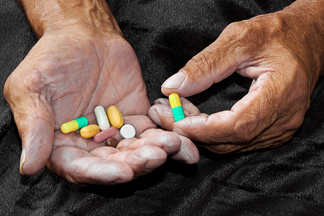 Image of caregiver reviewing prescription medication of a senior.  Assisted Living refers housing, personalized services, and health-related care designed to meet each individualized need of resident older adults.