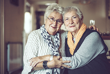 Image of two older adult friends holding each other. Looking for Care Assisted Living Resources - Is it time?