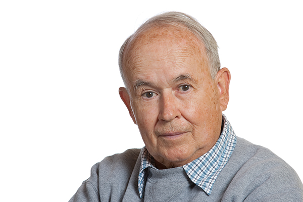 Image of inquisitive Senior Man looking for resources for memory care and other assisted living needs.